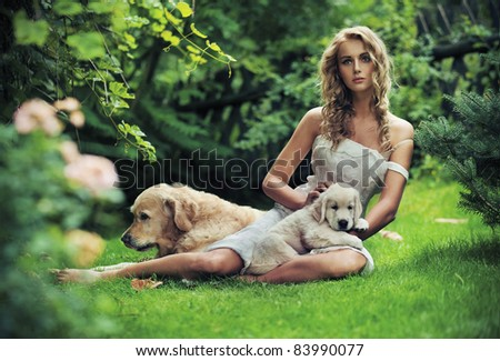 Cute woman with dogs in beauty nature scenery - stock photo