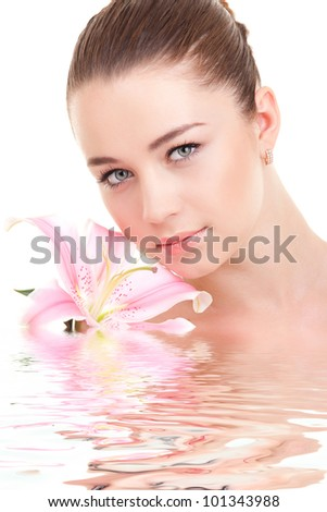 Cute woman with flower - stock photo