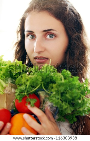 Cute woman with fresh salad and vegetables isolated on a white - stock photo