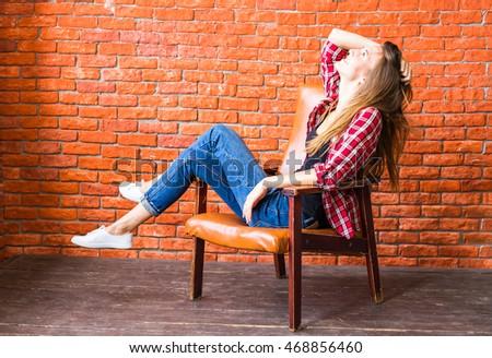 beautiful smart woman sits on chair stock photo 473260414