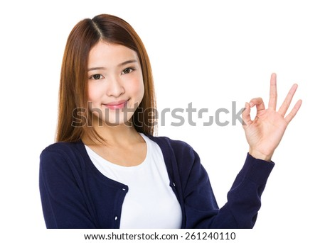 Cute woman with okay hand gesture - stock photo