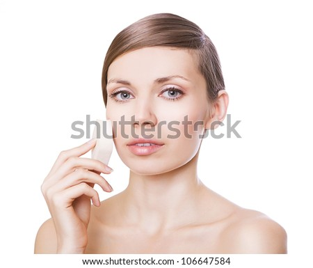 cute woman with powder puff on white background