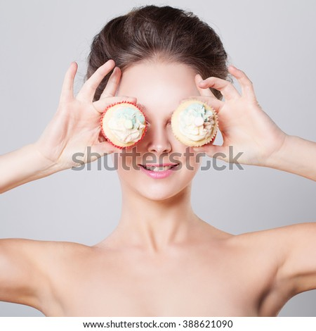 Cute Woman with Sweet Cup Cake - stock photo