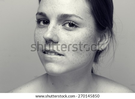 Cute woman young with freckle portrait black and white - stock photo