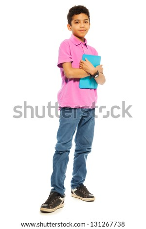 Cute 10 years old black boy standing with tablet computer, full height, isolated on white - stock photo