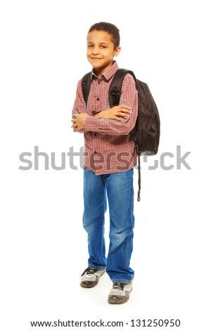 Cute 8 years old black boy with backpack - full height portrait isolated on white - stock photo