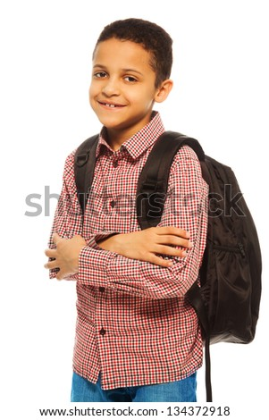 Cute 8 years old black boy with backpack - waist up portrait isolated on white - stock photo