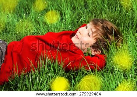 Cute 7 years old boy having fun outdoor. Summer day.  - stock photo