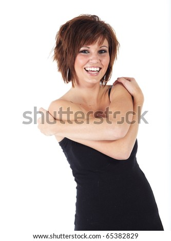 Cute young adult caucasian woman wearing a black top and with short brunette hair on a white background. Not Isolated