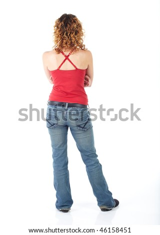 Cute young adult caucasian woman wearing a red top and jeans and with curly red hair on a white background. Not Isolated