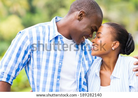 cute young african couple in love - stock photo
