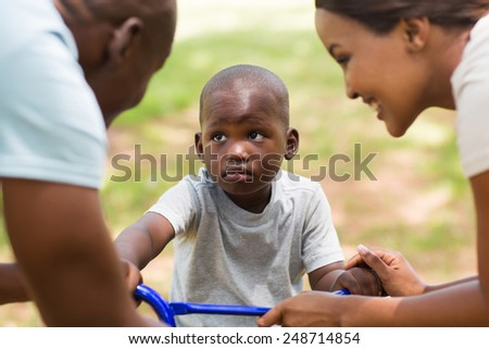 cute young african family playing outdoors - stock photo