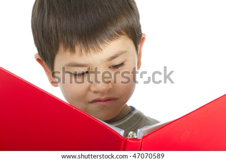 Cute young asian boy contemplating his homework isolated on white background