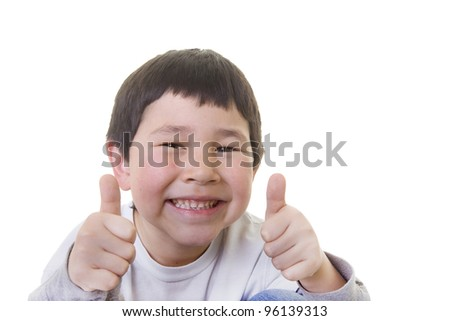 Cute young asian boy giving the two thumbs up sign isolated on white background
