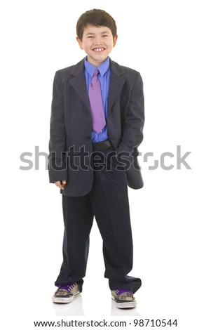 Cute young asian boy in suit and tie with great smile isolated on white background - stock photo