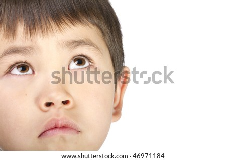 Cute young asian boy look up with a sad face, isolated on a white background