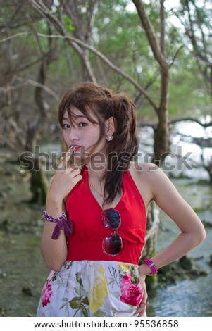 Cute young asian woman portrait on the beach.