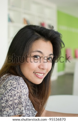 Cute young asian woman portrait outdoor scene.