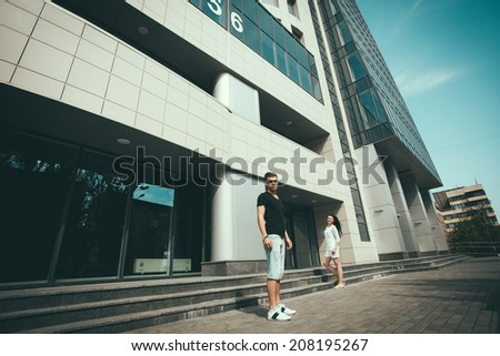 Cute young beautiful couple  in city near university after studying and having fun together laughing and smiling
