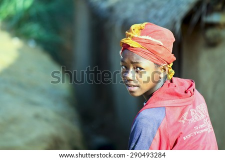 Cute young black African girl - poor child, madagascar - stock photo