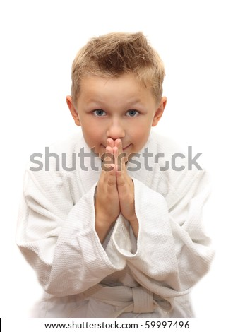 Cute young boy bowing