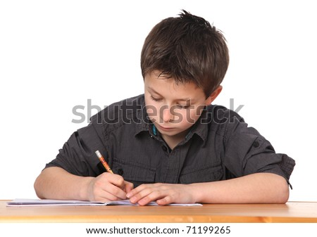 cute young boy doing homework