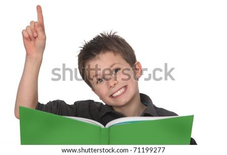 cute young boy doing homework - stock photo