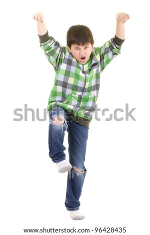 Cute young boy doing the karate kid pose isolated on white background