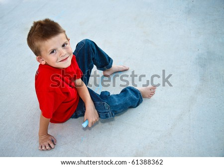 Cute, young boy enjoying the outdoors - stock photo
