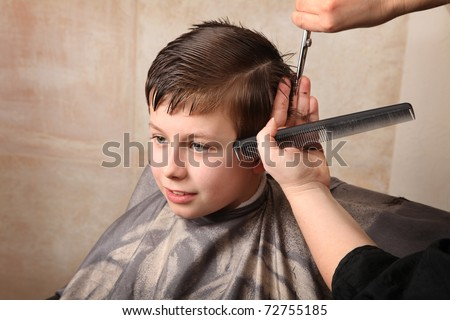 cute young boy getting a haircut