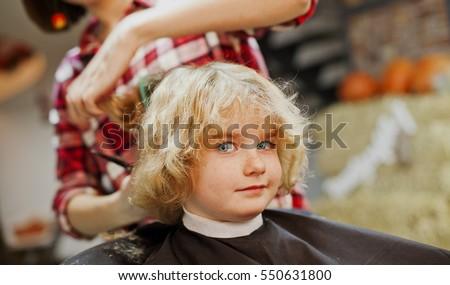 Cute Young Boy Getting A Haircut Barber Reaching Out To Cut Boys Hair