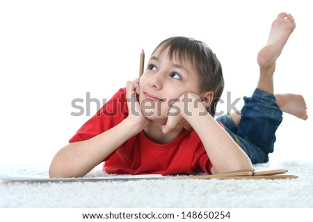 cute young boy in a red shirt on a white background