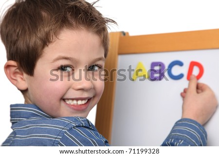 cute young boy learning the ABC