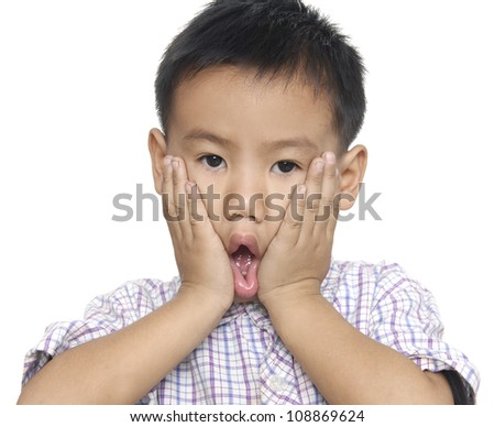 Cute young boy making a funny face - stock photo