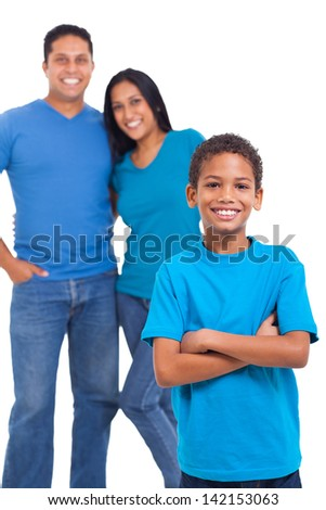 cute young boy standing in front of his parents over white background