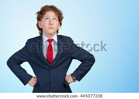 cute young boy thinking - stock photo