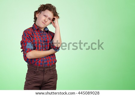 cute young boy thinking