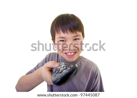 Cute young boy using the remote control isolated on white background - stock photo