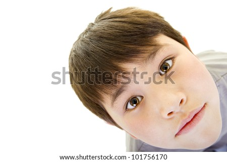 Cute young boy with serious look isolated on white background with room for your text
