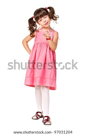 Cute young brunette girl points at you. Isolated over white - stock photo