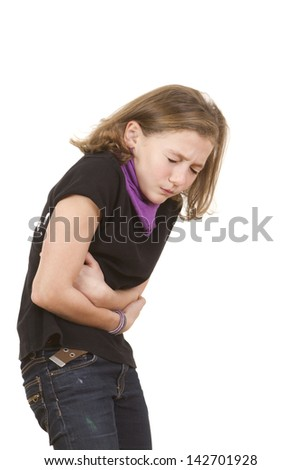 Cute young brunette girl with a severe stomach ache or nausea making a pained face. - stock photo