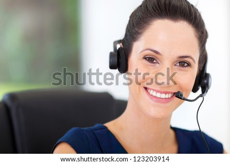 cute young business call center operator with headphones - stock photo