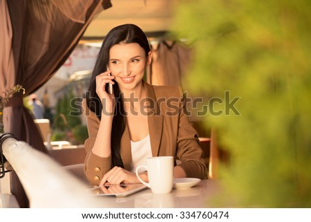Cute young business woman on lunch with coffee
