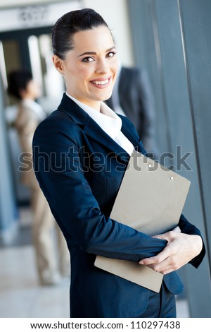 cute young businesswoman portrait in office - stock photo