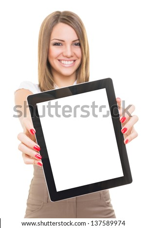 Cute young businesswoman smiling showing blank tablet screen - stock photo