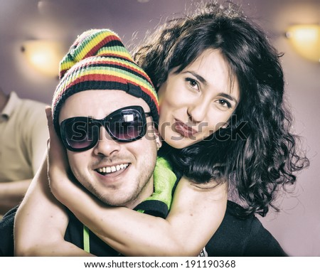 Cute young couple at party - stock photo