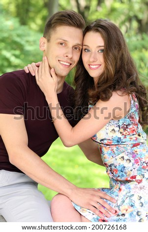 Cute, young couple in the park