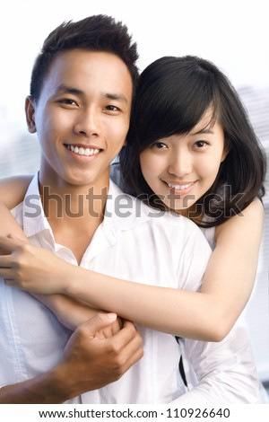 Cute young couple looking at camera - stock photo