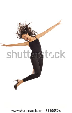 Cute young energetic woman dancing jumping in air