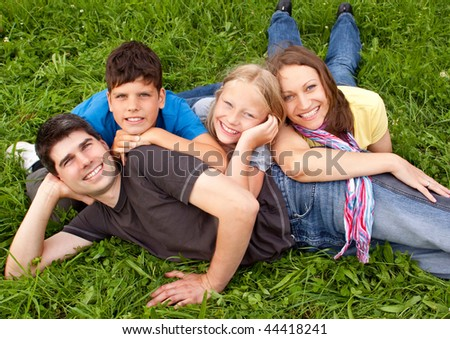 cute young family having fun in the nature - stock photo